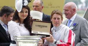 Bollywood superstar Aishwarya Rai Bachchan presents the King's Stand Stakes trophy to jockey Johnny Murtagh. Picture: Johnny Murtagh