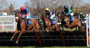AYR WE GO: Ballybogey (Ruby Walsh, left) on his way to victory in the West Sound Novices' Hurdle  at Ayr yesterday: Picture: Anna Gowthorpe/PA Wire