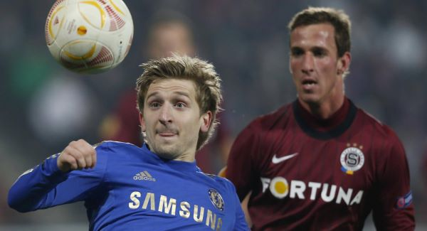 Sparta&#39;s Matej Hybs, right, looks on as Chelsea&#39;s Marko Marin, left, tries to control the ball.Picture: PA
