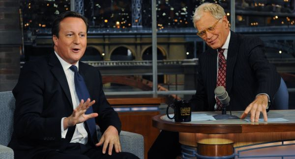 David Cameron (left) talks with talk show host David Letterman on the David Letterman Show in New York