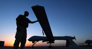 A US military crew chief completes a post-flight inspection of the RQ-1 Predator drone in Balad Air Base, Iraq.  Picture: Rob Jensen/USAF via Getty Images