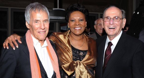 Legendary songwriters Bert Bacharach, left, and Hal David pose with singer Dionne Warwick at the Love, Sweet Love musical tribute to Hal David on his 90th birthday last October in Los Angeles.