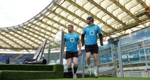 Jamie Heaslip and Rob Kearney make their way onto the pitch for the Captain&#39;s Run at the Stadio Olimpico in Rome. Picture: Brendan Moran/Sportsfile 