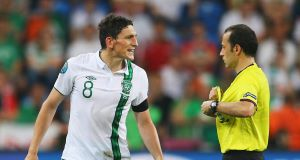 Keith Andrews is shown a red card by Cuneyt Cakir during Ireland's Euro 2012 clash with Italy. Picture: Christof Koepsel
