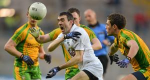OUTNUMBERED: Kildare's John Doyle tries to find a way past Donegal's Martin McElhinney and Declan Walsh. Picture: Barry Cregg/Sportsfile