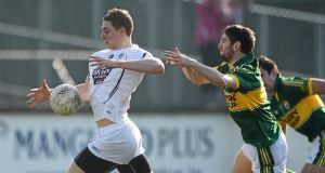ON A SURGE: Kildare's Daniel Flynn bursts clear of Kerry's Killian Young in last weekend's Allianz FL Division 1 game at St Conleth's Park, Newbridge. Picture: David Maher/Sportsfile