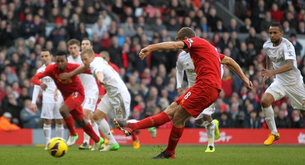 Gerrard slots in the first from the spot.Picture: PA