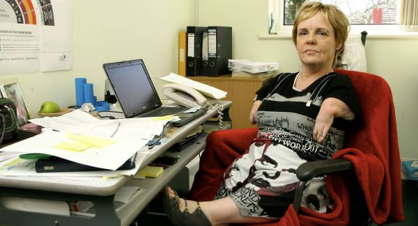 Irish Thalidomide Association chairwoman Maggie Woods at her desk. 'I am still here fighting for justice,' she says