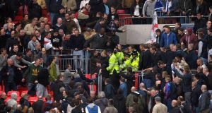 Trouble breaks out in the stands between the Millwall fans and police during the FA Cup semi final at Wembley last weekend. Picture: PA