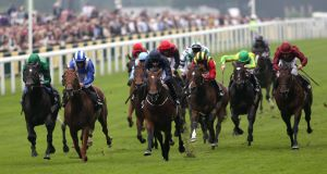 Declaration of War ridden by Joseph O'Brien (dark blue) wins The Queen Anne Stakes. Picture: PA