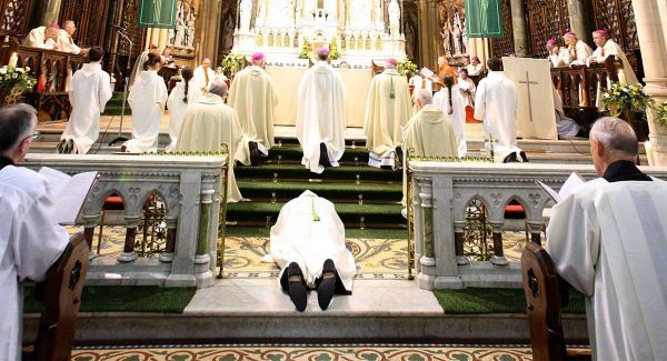 Canon William Crean prostrated before the alter of St Colman's Cathedral, Cobh as he was ordained the 67th Bishop of Cloyne today. Picture: Denis Hyland Photography
