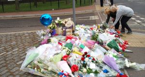 Women lay flowers outside the Royal Artillery Barracks in Woolwich. Picture: Max Nash/PA Wire